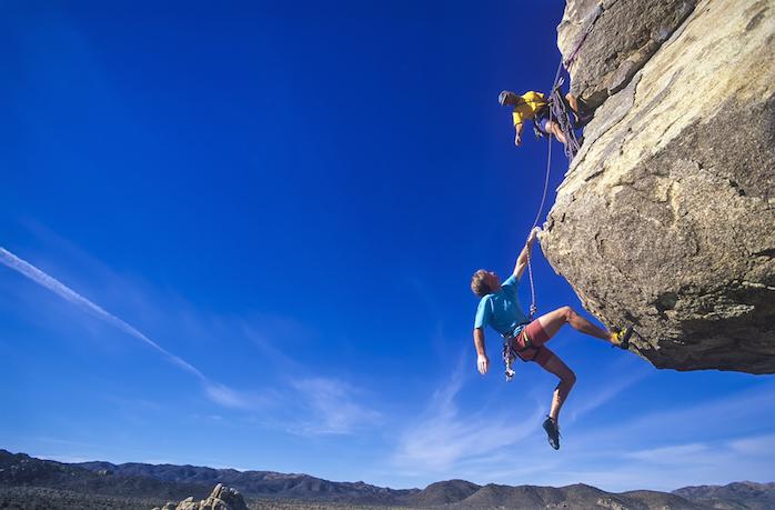 rock climbers hanging down