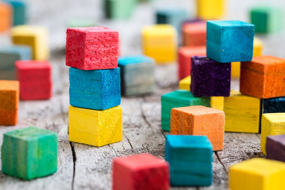 colorful building blocks to represent development of reporting strategy