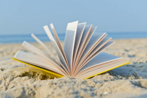 book open in the sand
